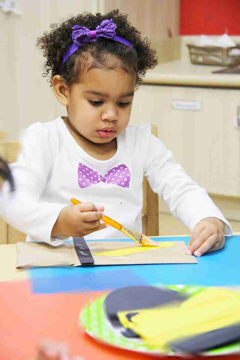 Child painting with paintbrush