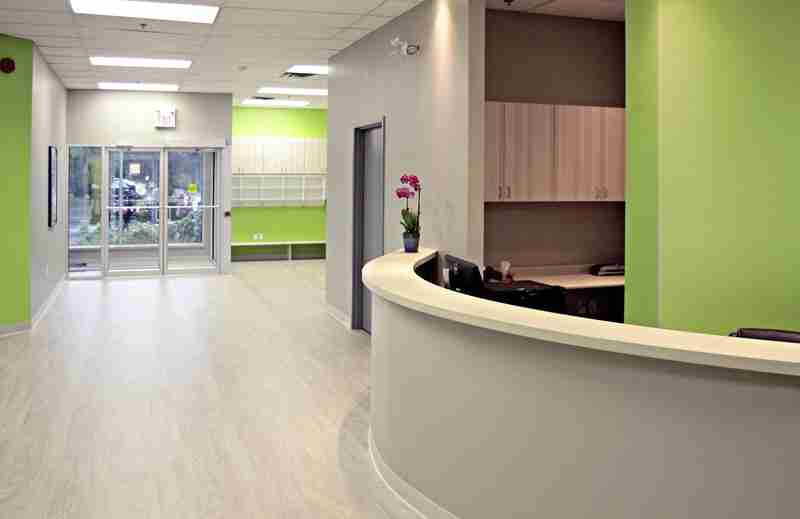 Reception area with green and gray walls with a view of the entrance