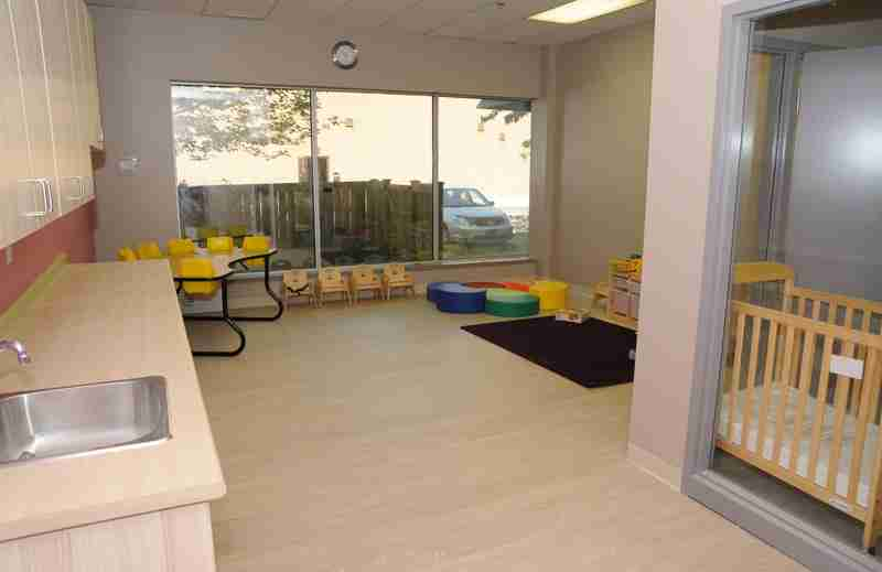 Interior of SimplySmart Child Care Centre with sink, crib and small chairs