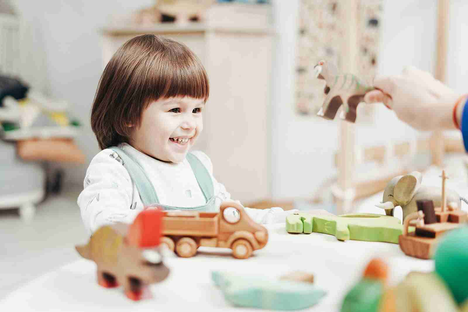 Child playing with educational toys at Montessori school