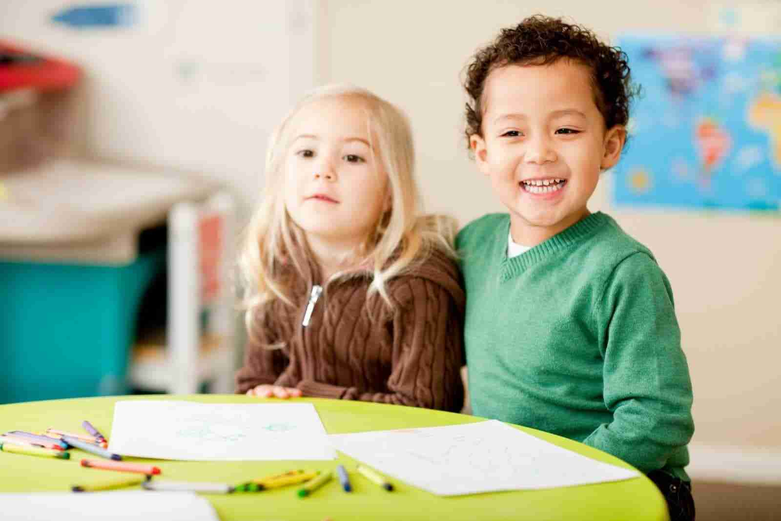 Children sitting in front of table in the best daycare