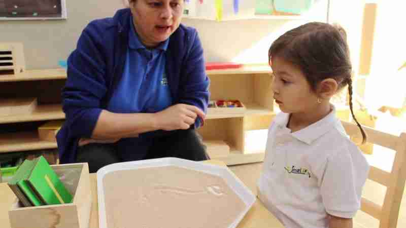 Teacher teaching child at SimplySmart daycare in Mississauga