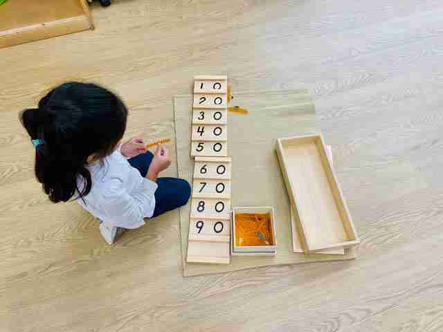 Child playing with wooden numbers at SimplySmart Child Care - Vaughan